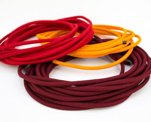 Cavi tessili in tonalità del rosso